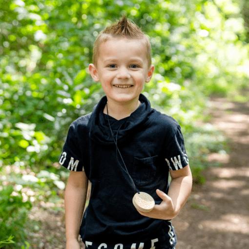 jongen met bijtketting cookie